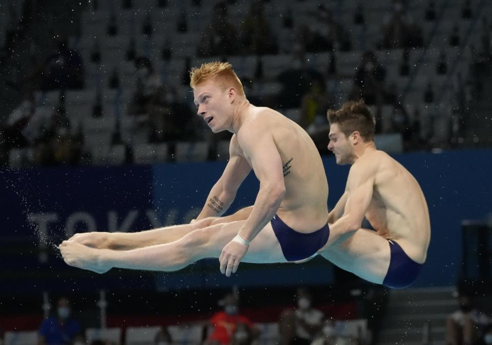 CORRECTS TO HIXON FROM NIXON - Andrew Capobianco and Michael Hixon of the United States' compete during the men's Synchronized 3m Springboard Final at the Tokyo Aquatics Centre at the 2020 Summer Olympics, Wednesday, July 28, 2021, in Tokyo, Japan. (AP Photo/Dmitri Lovetsky)