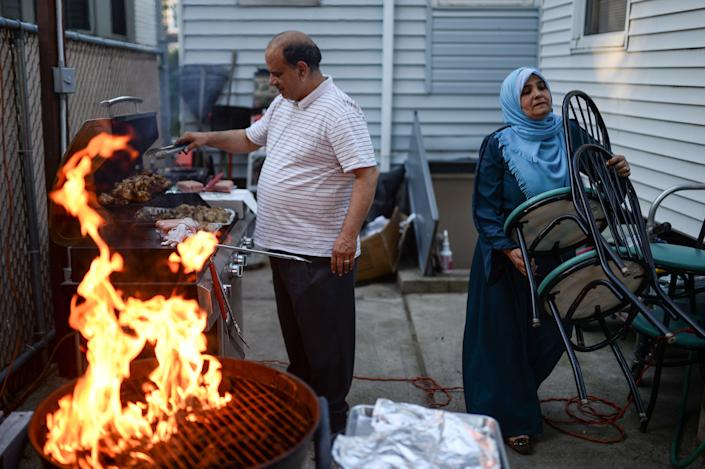 Egyptian born Muslim Americans Ahmed Sayedahmed and wife Sahar Sayedahmed grill meat and make preparations for a college graduation celebration and Iftar feast for their daughter during Ramadan in Bayonne, New Jersey, U.S. June 2, 2017. Picture taken June 2, 2017. REUTERS/Amr Alfiky