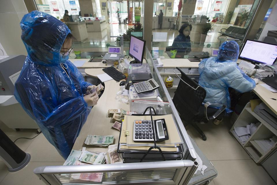SHANXI, CHINA - FEBRUARY 24: (CHINA MAINLAND OUT)The bank workers sanitize the cash to kill the novel coronavirus on 24th February, 2020 in Taiyuan,Shanxi,China.(Photo by TPG/Getty Images)