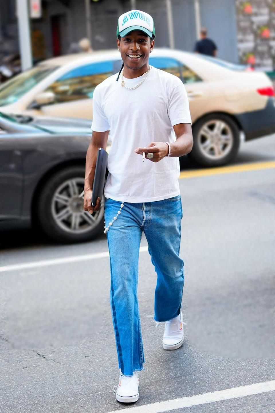 <p>A$AP Rocky rocks a white tee, jeans and sneakers while out in N.Y.C. on June 30.</p>
