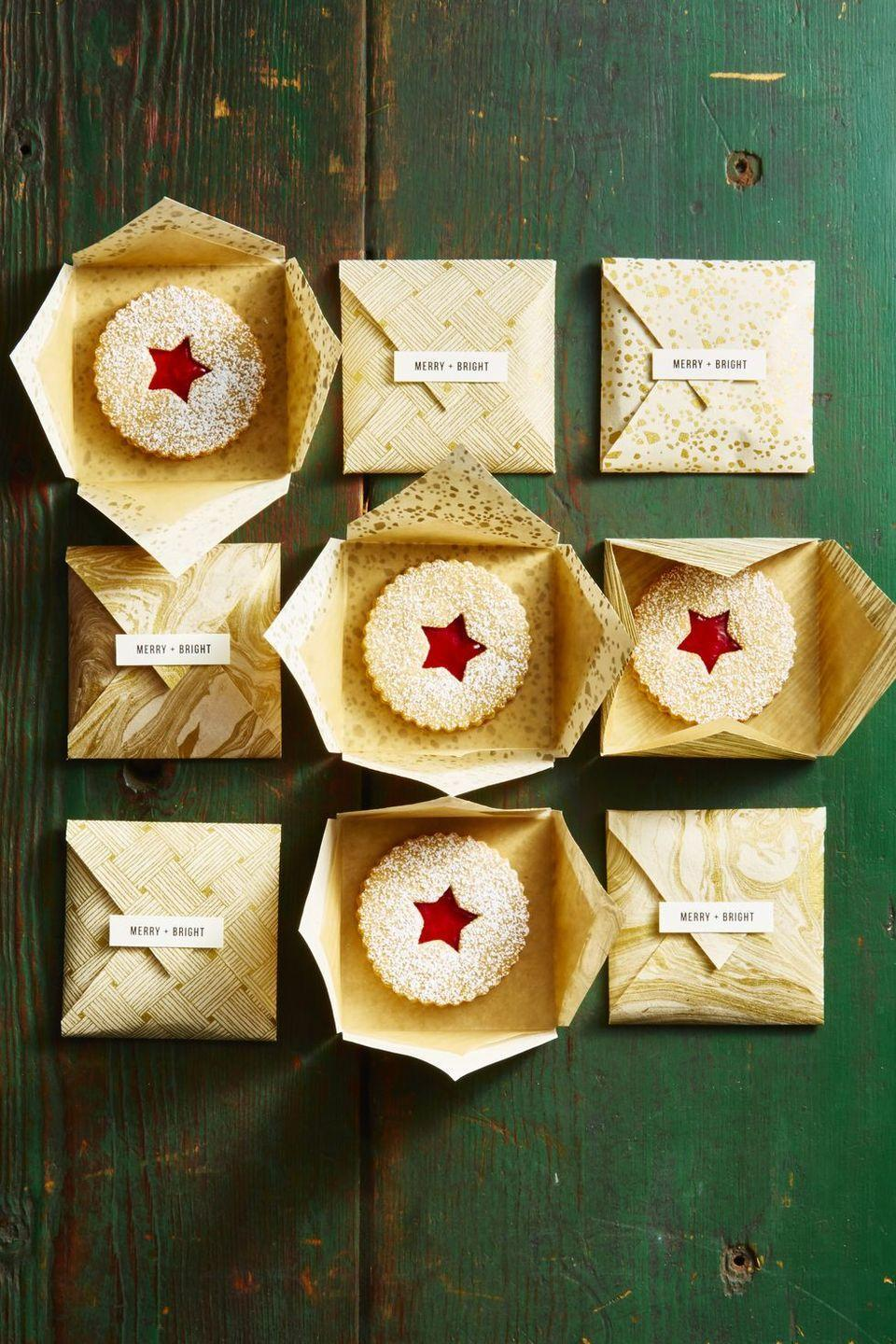 """<p>It's what's on the inside that counts. Wrap each cookie in a personalized paper envelope to gift to all your loved ones this holiday season.</p><p><em><a href=""""https://www.goodhousekeeping.com/food-recipes/dessert/a46807/jam-sandwich-cookie-recipe/"""" rel=""""nofollow noopener"""" target=""""_blank"""" data-ylk=""""slk:Get the recipe for Jam Sandwich Cookies »"""" class=""""link rapid-noclick-resp"""">Get the recipe for Jam Sandwich Cookies »</a></em></p>"""