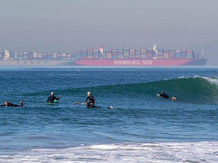About 20 container ships waiting to be unloaded at ports in LA and Long Beach