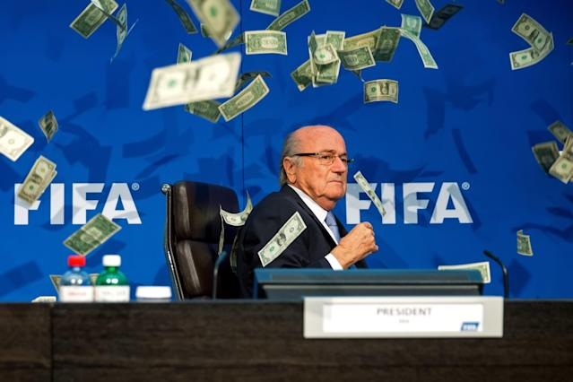 "<h1 class=""title"">Extraordinary FIFA Executive Committee Meeting</h1> <div class=""caption""> ZURICH, SWITZERLAND - JULY 20: A comedian attacked FIFA President Joseph S. Blatter with money during a press conference at the Extraordinary FIFA Executive Committee Meeting at the FIFA headquarters on July 20, 2015 in Zurich, Switzerland. (Photo by Philipp Schmidli/Getty Images) </div> <cite class=""credit"">Philipp Schmidli</cite>"
