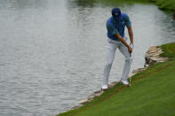 Jordan Spieth eagles from the rough on the sixth green to complete his second consecutive eagle for the day in the second round at the Northern Trust golf tournament, Friday, Aug. 20, 2021, at Liberty National Golf Course in Jersey City, N.J. (AP Photo/John Minchillo)