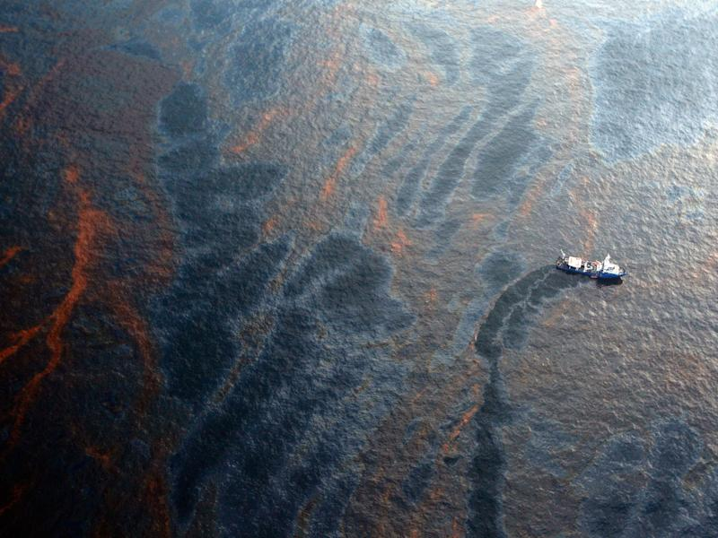 A boat works to collect oil that has leaked from the Deepwater Horizon wellhead in the Gulf of Mexico: Getty