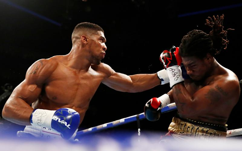 Charles Martin in action with Anthony Joshua Action - Reuters