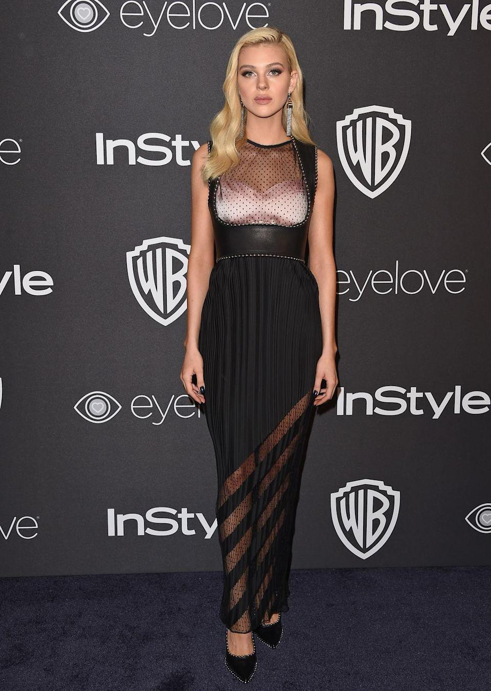 <p>Peltz rocked up at the Beverly Hilton Hotel wearing a sheer ankle-length black dress, which featured an asymmetric skirt pattern and light pink bra underneath the dress' leather cut-out bust. </p>