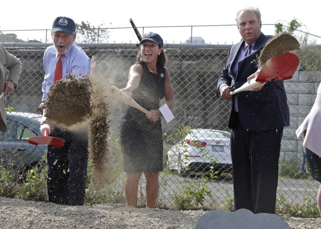 From left, Worcester Red Sox Chairman Larry Luchino, Mass. Lt. Gov. Karyn Polito, and Worcester Mayor Joe Petty shovel dirt during a groundbreaking ceremony for a new minor league baseball stadium, Thursday, July 11, 2019, in Worcester, Mass. Polar Park will be the new home of the Boston Red Sox' Triple-A affiliate, beginning in 2021. The club announced last year that it is moving from Pawtucket, R.I. to Worcester after failing to reach a deal for a new stadium with Rhode Island officials. (AP Photo/Elise Amendola)
