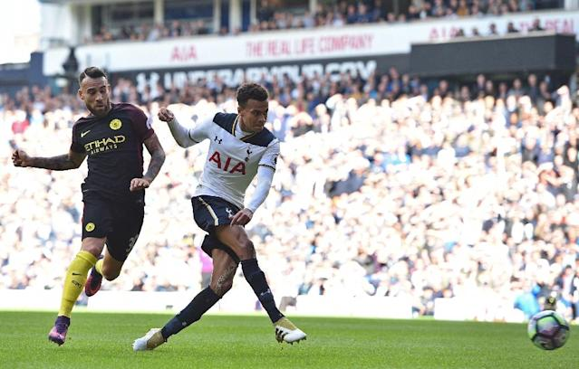 Dele Alli (right) scores Tottenham Hotspur's second goal against Manchester City at White Hart Lane on October 2, 2016 (AFP Photo/Glyn Kirk)