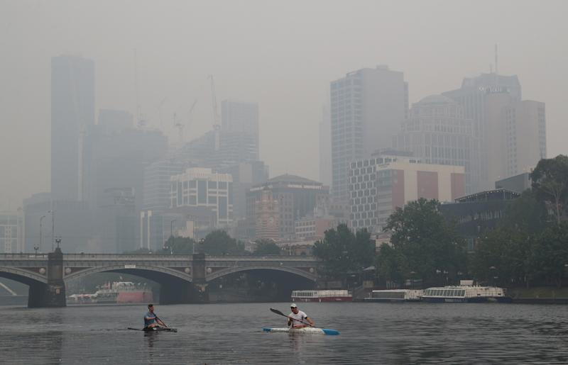 Pictured are people kayaking in Melbourne as the city is blanketed in smoke.