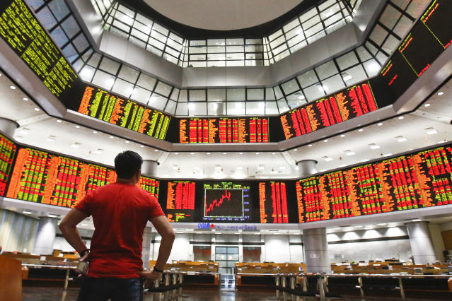 Stock markets have generally moved into the green for this year, but a number of fund managers are warning that they don't expect this to last. (AP Photo/Sadiq Asyraf)