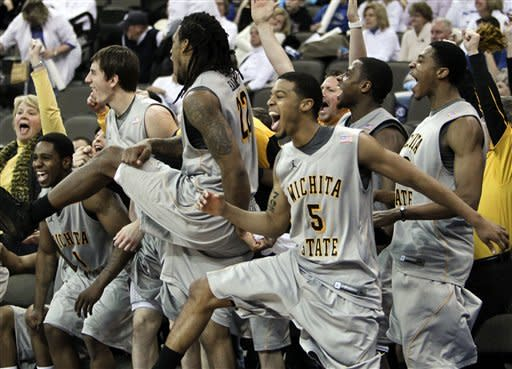 Wichita State players, from left to right, Joe Ragland, Jake White, Carl Hall, Demetric Williams and Toure' Murry celebrate in the closing seconds of their NCAA college basketball game against Creighton in Omaha, Neb., Saturday, Feb. 11, 2012. Wichita State won 89-68. (AP Photo/Nati Harnik)