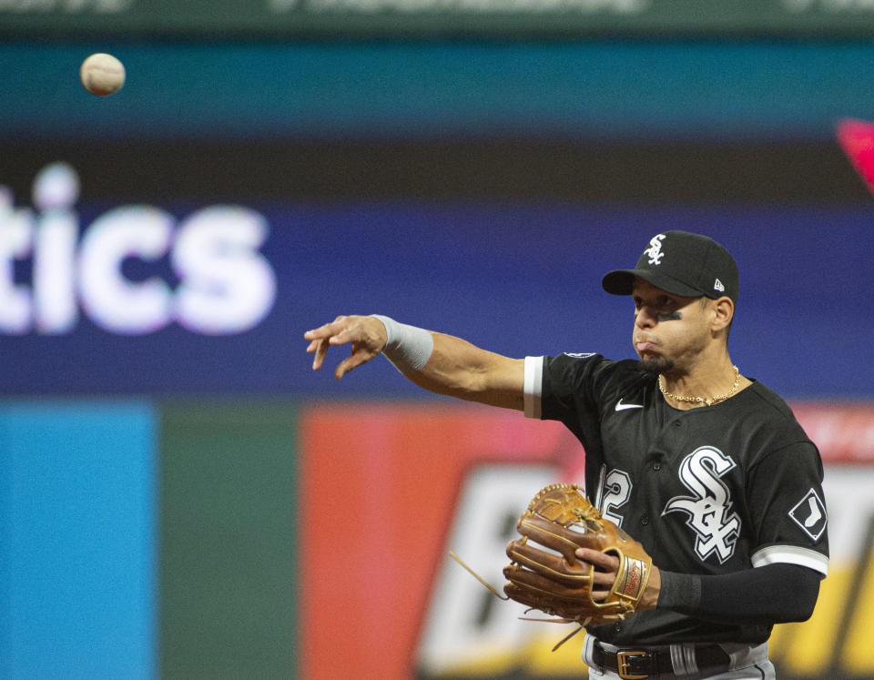 Chicago White Sox's Cesar Hernandez throws Cleveland Indians' Amed Rosario out at first base during the third inning of a baseball game in Cleveland, Saturday, Sept. 25, 2021. (AP Photo/Phil Long)