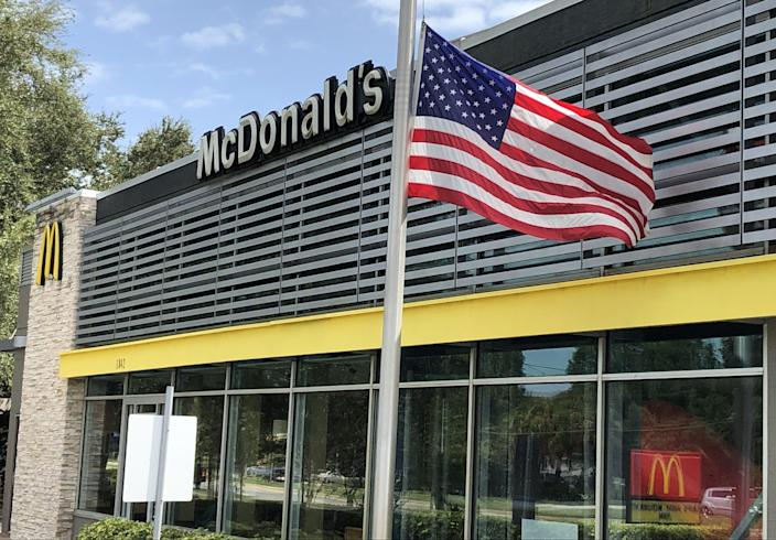 Following the death of Supreme Court Justice Ruth Bader Ginsburg, a flag flies at half staff on Monday, Sept. 21, 2020, in front of a McDonald's restaurant in New Smyrna Beach, Florida. McDonald's has been falsely accused of removing U.S. flags in support of Antifa and the Black Lives Matter movement. [Mark Harper/USA TODAY Network]