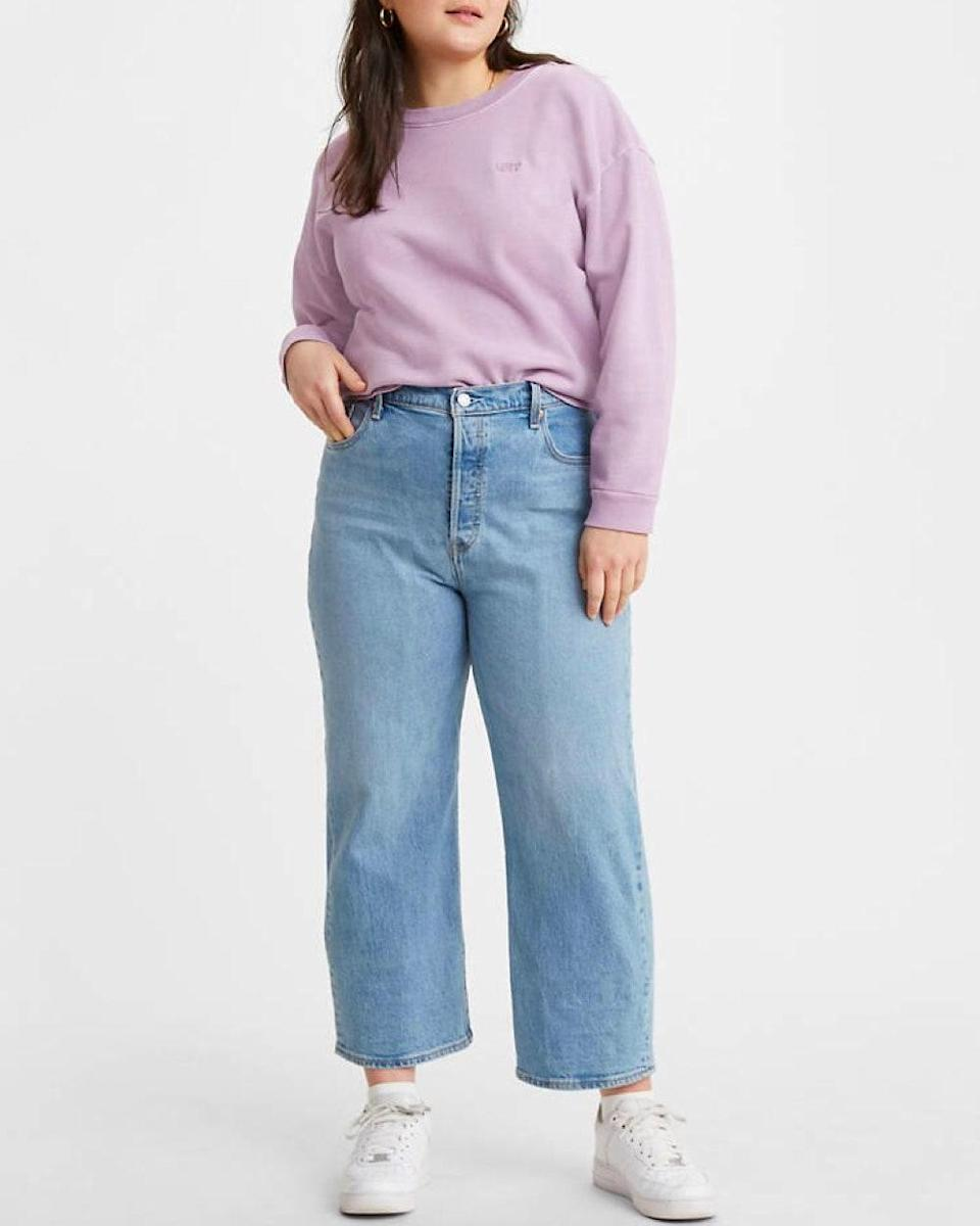 "Finally, the beloved vintage-inspired look for plus-size women! The Levi's Ribcage Jeans are possibly my favorite jeans of all time. They fit <em>so</em> well and have that vintage look that is very on-trend but difficult to find in plus sizes. They are 99% cotton so it gives them that classic rigid denim look, but have 1% elastane that gives them a little stretch for comfort. —<a href=""https://www.instagram.com/raeannlangas/"" rel=""nofollow noopener"" target=""_blank"" data-ylk=""slk:Rae"" class=""link rapid-noclick-resp""><em>Rae</em></a><em>, size 32, Los Angeles</em> $98, Levi's. <a href=""https://www.levi.com/US/en_US/clothing/women/plus-size/jeans/ribcage-straight-ankle-womens-jeans-plus-size/p/388430002"" rel=""nofollow noopener"" target=""_blank"" data-ylk=""slk:Get it now!"" class=""link rapid-noclick-resp"">Get it now!</a>"