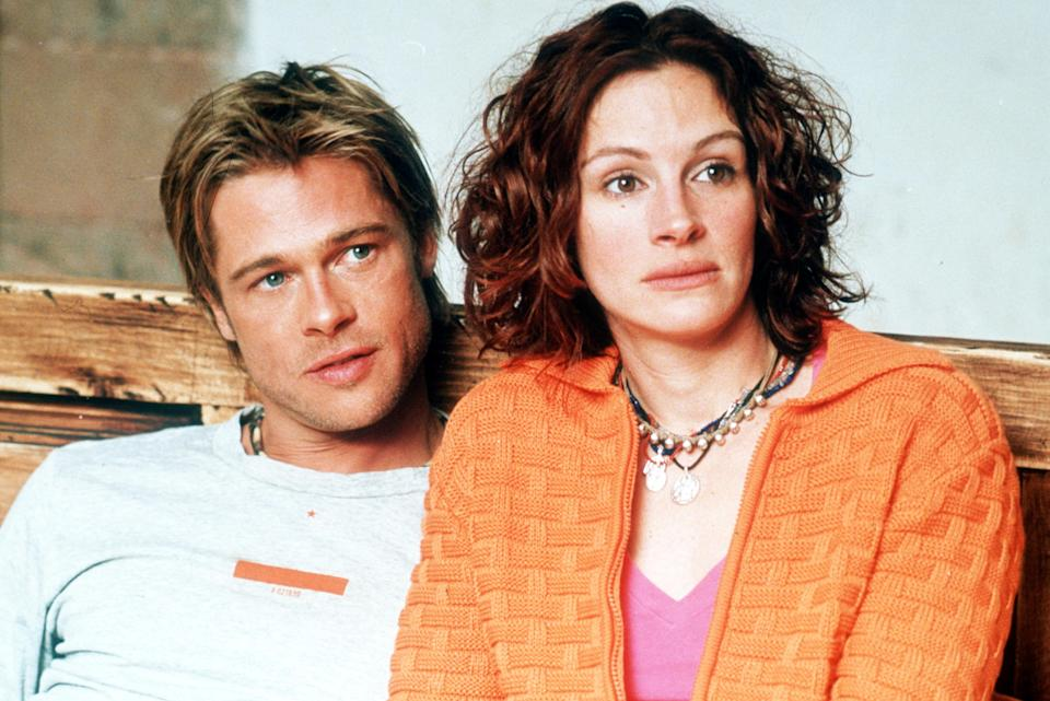 383845 01: Actors Brad Pitt and Julia Roberts act in a scene in Dream Works Pictures