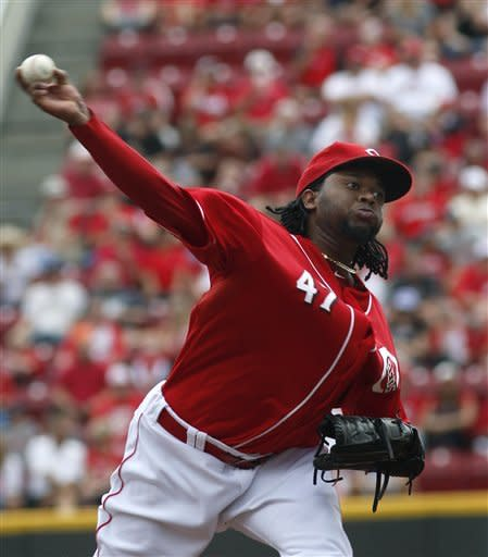 Cincinnati Reds' Johnny Cueto pitches against the Houston Astros in the first inning of their baseball game in Cincinnati, Sunday Sept. 9, 2012. (AP Photo/Tom Uhlman)