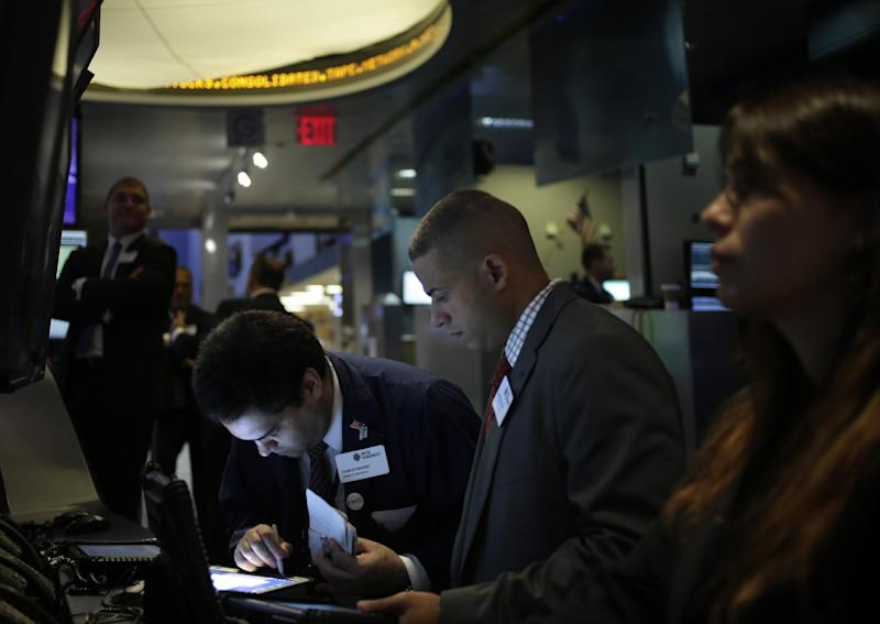 FILE - In this Tuesday, Sept. 3, 2013, file photo, traders work on the floor at the New York Stock Exchange in New York. An Associated Press poll released Tuesday, Sept. 17, 2013 of more than two dozen economists suggests that global growth will remain below full health into 2014. (AP Photo/Seth Wenig, File)