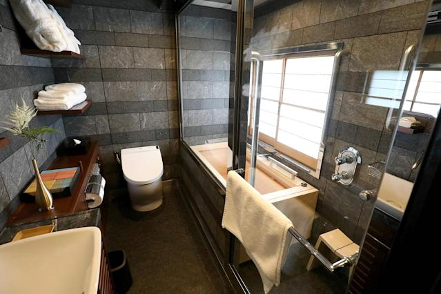 <p>The bathroom set in the Shiki-shima Suite includes a separate shower stall and tub. (Photo: STR/AFP/Getty Images) </p>
