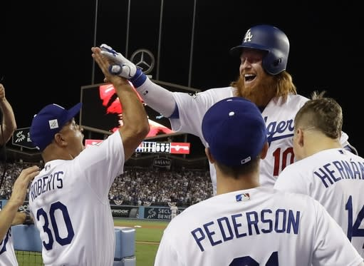 Los Angeles Dodgers' Justin Turner celebrates his two-run home run during Game 1 of the World Series. (AP)
