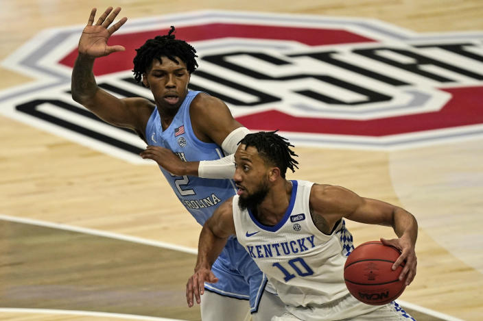 Kentucky's Davion Mintz (10) drives past North Carolina's Caleb Love (2) in the second half of an NCAA college basketball game, Saturday, Dec. 19, 2020, in Cleveland. North Carolina won 75-63. (AP Photo/Tony Dejak)