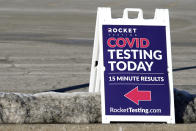 A COVID-19 testing site sign is seen at the Hawthorn Mall parking lot in Vernon Hills, Ill., Thursday, Jan. 21, 2021. A new drive-up rapid COVID-19 testing facility has opened in Vernon Hills. Rocket Testing, which currently has seven locations in the Chicago area. (AP Photo/Nam Y. Huh)