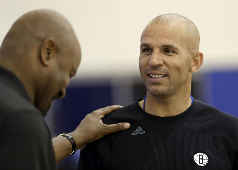 Brooklyn Nets general manager Billy King, left, talks with head coach Jason Kidd during NBA basketball training camp at Duke University in Durham, N.C., Tuesday, Oct. 1, 2013. (AP Photo/Gerry Broome)