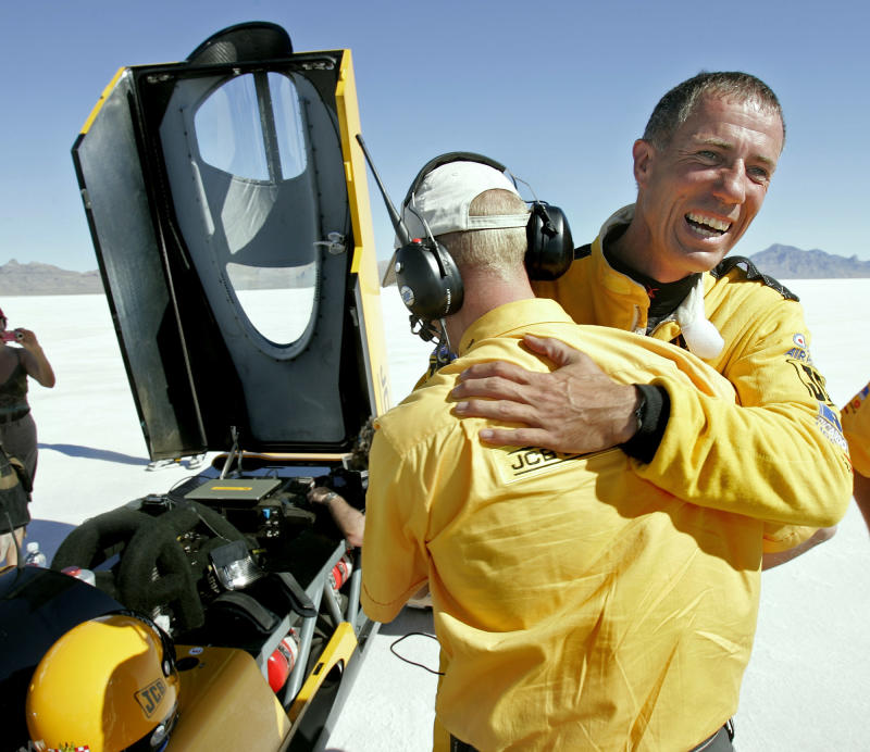 "FILE - This is a Tuesday, Aug. 22, 2006 file photo of British driver Andy Green, right, as he is congratulated by a crew member after setting a new unofficial world diesel powered land speed record of over 328 mph over two runs  on the Bonneville Salt Flats in Utah.. Toiling with shovels, wheelbarrows and bare hands, about 300 workers in a remote corner of South Africa removed 6,000 tons of stones and other debris _ roughly 20 tons per person _ from a vast stretch of desert over the past year. If all goes well, it will become the globe's fastest race track when a British-led team tries to break the world land-speed record in 2015.  ""It will be a brisk ride,"" said Andy Green, the man who plans to break his own record. His goal this time? A flabbergasting 1,610 kilometers (1,000 miles) an hour. The track of hard-packed earth at the Hakskeen Pan, tucked between Namibia and Botswana, is 1.1 kilometers (0.7 miles) wide and 20 kilometers (12.5 miles) long.  (AP Photo/Douglas C. Pizac, File)"