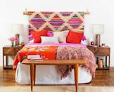 "<p>Try some bold color on for size. An eclectic rug draped over a rod adds pattern minus the commitment. Ground an exotic pick with plenty of wooden accents and a modern touch, like a metallic lamp. </p><p><em><a href=""https://www.goodhousekeeping.com/home/decorating-ideas/tips/a26406/bedroom-makeover-headboard-diy/"" rel=""nofollow noopener"" target=""_blank"" data-ylk=""slk:Get the tutorial »"" class=""link rapid-noclick-resp"">Get the tutorial »</a></em></p>"
