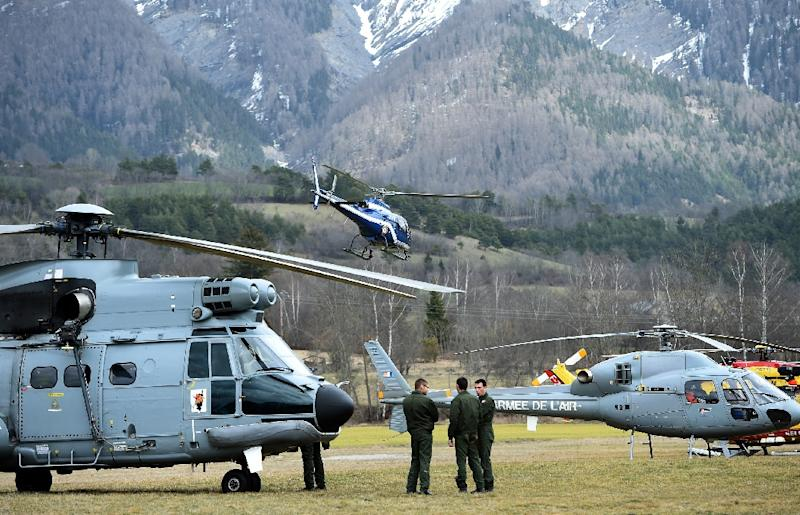 Helicopters of the French Air Force and civil security services are pictured in Seyne (AFP Photo/Anne-Christine Poujoulat)