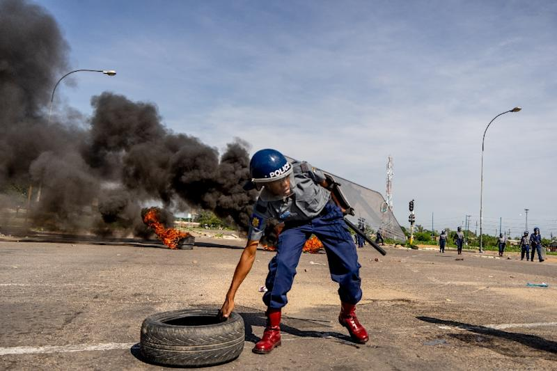 A government decision to double fuel prices sparked violent protests as Zimbabwe struggles with its worst fuel shortages in a decade (AFP Photo/Zinyange AUNTONY)