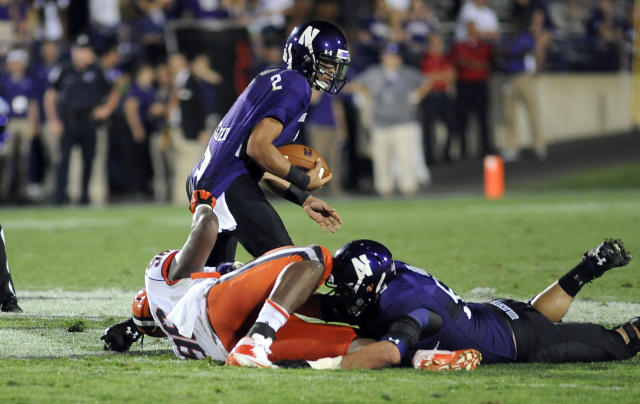 Syracuse's Jay Bromley (96) sacks Northwestern's Kain Colter (2) in the second half of an NCAA college football game in Evanston, Ill., Saturday, Sept. 7, 2013. (AP Photo/Matt Marton)