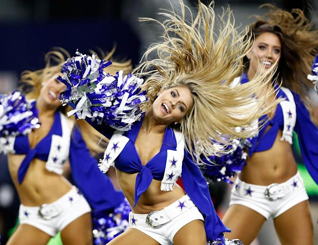 <p>The Dallas Cowboys Cheerleaders perform before the start of the football game against the Washington Redskins at AT&T Stadium on November 30, 2017 in Arlington, Texas. (Photo by Wesley Hitt/Getty Images) </p>