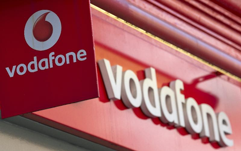 British mobile phone giant Vodafone is to merge its Indian unit with Idea Cellular (AFP Photo/JUSTIN TALLIS)