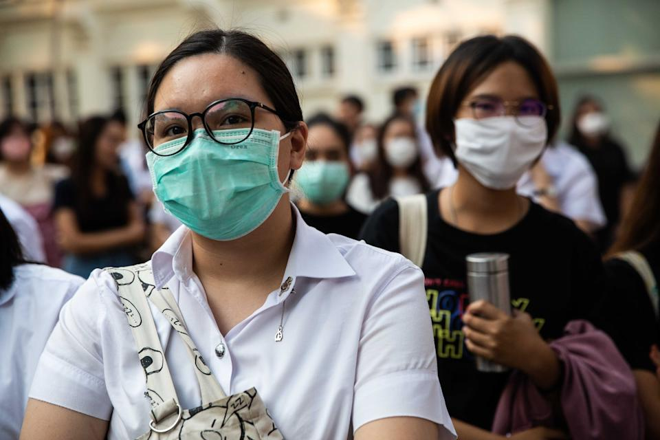 BANGKOK, THAILAND - FEBRUARY 24: Students in central Bangkok protest the dissolution of the Future Forward Party while wearing face masks to protect themselves against Covid-19 at Chulalongkorn University on February 24, 2020 in Bangkok, Thailand. Thailand's Constitutional Court last week ordered the dissolution of the popular Future Forward Party, after finding the party guilty of violating election law by accepting a loan from its founder. The Future Forward Party acted as the opposition to the Thai military and leaders of Parliament.Ê (Photo by Lauren DeCicca/Getty Images)