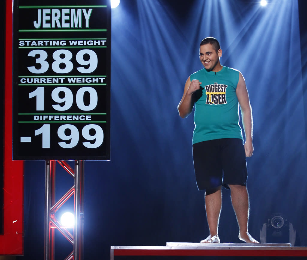 """""""Biggest Loser"""" crowned Jeremy Britt its Season 13 champion during Tuesday night's live finale. The 22-year-old banker from Rockford, Michigan began the competition at 389 pounds and weighed-in at 190 pounds during the finale, giving him a 199-pound weight-loss. With the highest percentage of weight-loss on-campus this season, Jeremy bested his sister Conda Britt and former pro-wrestler Kim Nielsen on the scales and claimed the $250,000 grand prize. He almost lost his chance at winning the grand prize when he was eliminated in week 14, but was brought back as part of a surprising twist."""