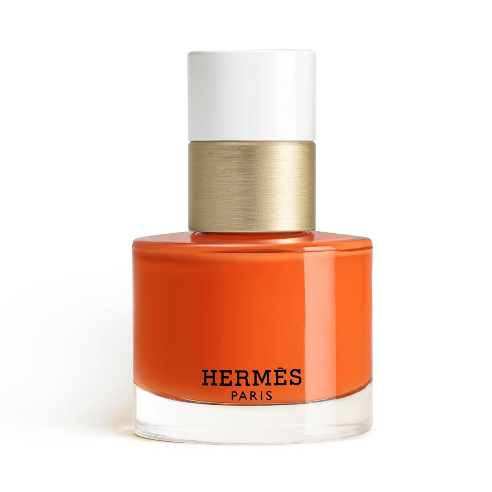 """Despite its storied history, Hermès is quite <a href=""""https://www.allure.com/story/hermes-lipstick-launch?mbid=synd_yahoo_rss"""" rel=""""nofollow noopener"""" target=""""_blank"""" data-ylk=""""slk:new to the beauty space"""" class=""""link rapid-noclick-resp"""">new to the beauty space</a>, but it's already getting everything so right. Case in point: Les Mains Hermès Nail Enamel, which launches in October 2021. The fascinatingly opulent collection of 24 shades — including Orange Boîte, the design house's signature color — is 10-free but full of intensity, richness, and elegance."""