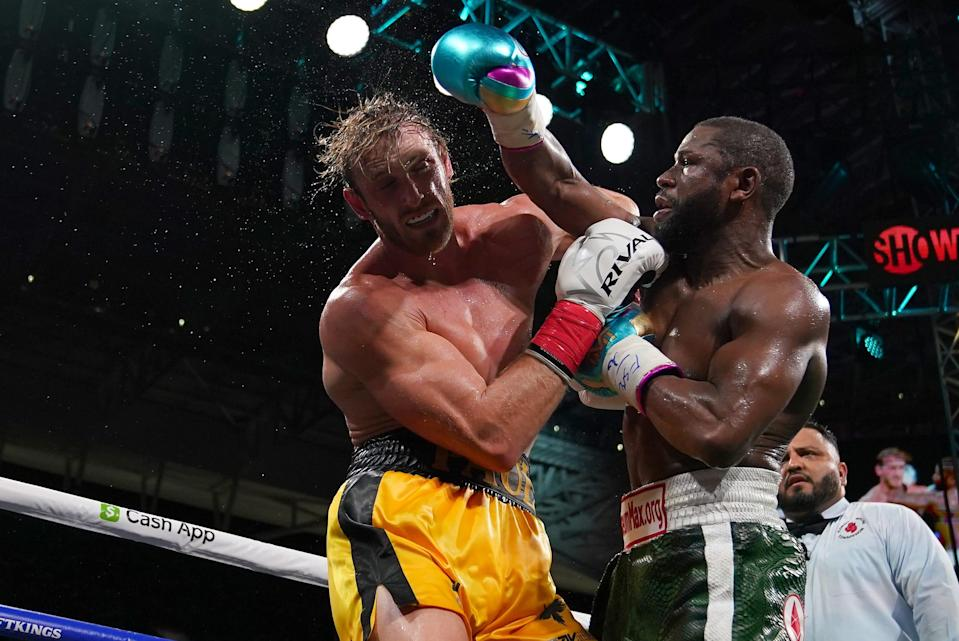 Floyd Mayweather Jr., right, fights Logan Paul during an exhibition boxing match Sunday in Miami.