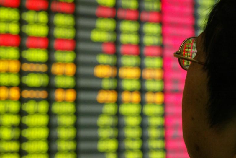 A Chinese investor monitors share prices at a securities company in Shanghai November 12, 2003. REUTERS/Claro Cortes IV/File Photo