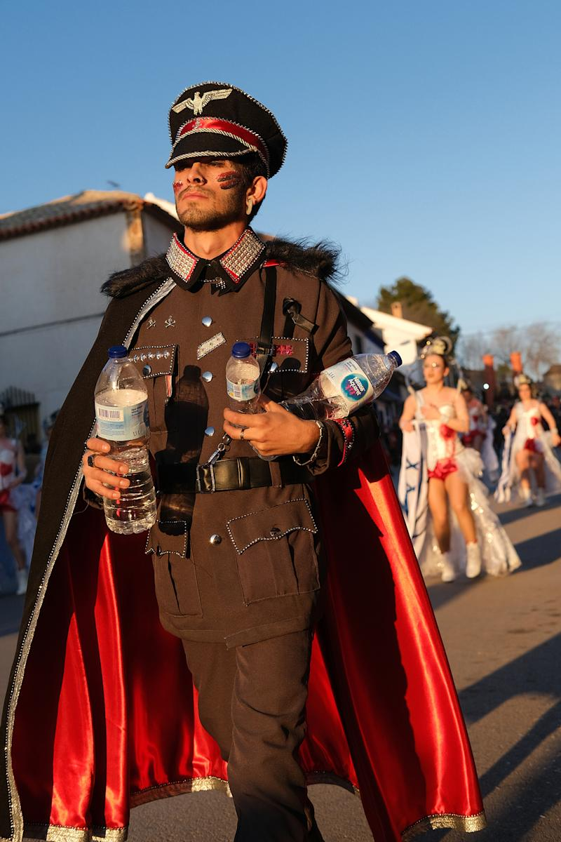 CAMPO DE CRIPTANA, SPAIN - FEBRUARY 24: A man dressed as a nazi soldier is seen in a Holocaust-themed parade during Carnival festivities on February 24, 2020 in Campo de Criptana, Spain. The Embassy of Israel in Spain denounced the display as trivializing the Holocaust. (Photo by Rey Sotolongo /Europa Press via Getty Images)