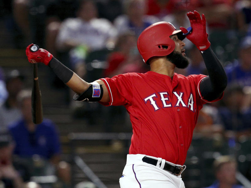 Texas Rangers' Nomar Mazara watches a home run against the Kansas City Royals in the fifth inning of a baseball game Friday, May 25, 2018, in Arlington, Texas. (AP Photo/Richard W. Rodriguez)