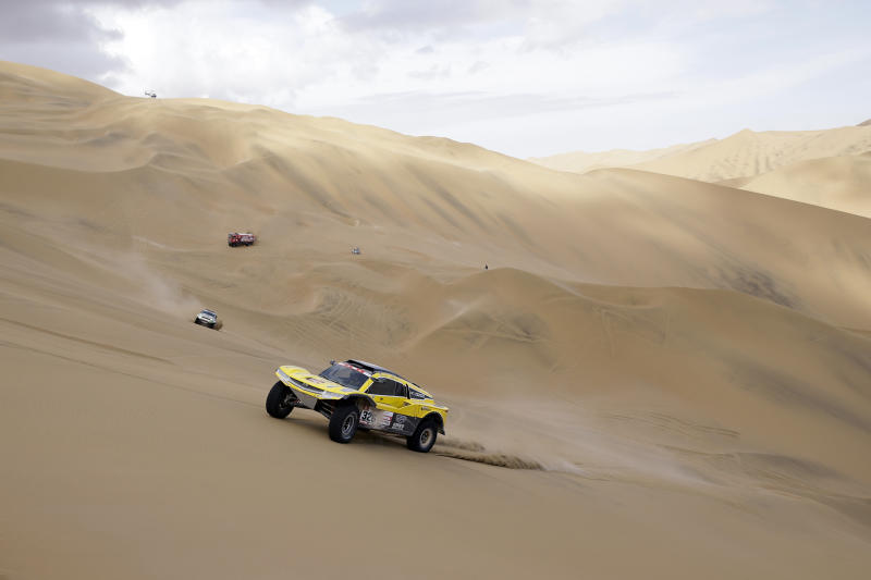 Driver Philippe Gache, of France, and co-driver Stephane Prevot, of Belgium, race their Buggy during the stage five of the Dakar Rally between Tacna and Arequipa, Peru, Friday, Jan. 11, 2019. (AP Photo/Ricardo Mazalan)