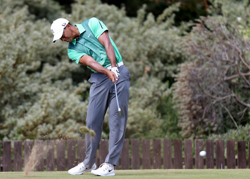 Tiger Woods plays a shot during a practice round ahead of the British Open Golf Championship, Muirfield, Scotland, Sunday, July 14, 2013. The British Open begins on Thursday, July 18. (AP Photo/Scott Heppell)