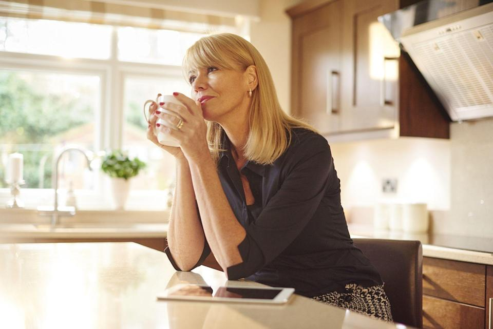 """<p>Reaching middle age usually means a few major life adjustments — retirement, a newly empty nest, or health changes. Sometimes, it means all of the above, or a slew of different changes entirely. It can also mean becoming more familiar with the <a href=""""https://www.womansday.com/health-fitness/a30515712/how-menopause-affects-mental-health/"""" rel=""""nofollow noopener"""" target=""""_blank"""" data-ylk=""""slk:signs of a midlife crisis"""" class=""""link rapid-noclick-resp"""">signs of a midlife crisis</a>, either in yourself or your peers. </p><p>Though the <a href=""""https://www.psychologytoday.com/us/conditions/midlife#:~:text=Psychologist%20Elliot%20Jaques%20coined%20the,remaining%20years%20of%20productive%20life."""" rel=""""nofollow noopener"""" target=""""_blank"""" data-ylk=""""slk:term midlife crisis"""" class=""""link rapid-noclick-resp"""">term midlife crisis</a> is fairly common, it's actually only existed since the mid-1960s, according to Psychology Today. Coined by psychologist Elliot Jacques, """"<a href=""""https://www.psychologytoday.com/us/conditions/midlife#:~:text=Psychologist%20Elliot%20Jaques%20coined%20the,remaining%20years%20of%20productive%20life."""" rel=""""nofollow noopener"""" target=""""_blank"""" data-ylk=""""slk:midlife crisis"""" class=""""link rapid-noclick-resp"""">midlife crisis</a>"""" was originally used to describe the period of life where adults tend to """"reckon with their mortality,"""" as the same Psychology Today article explains. In other words, the phenomenon can be a little more complicated than how it's often portrayed — it's more than just someone purchasing a fancy car or picking up an unexpected hobby. As Baltimore-based therapist and co-founder of <a href=""""https://withtherapy.com/"""" rel=""""nofollow noopener"""" target=""""_blank"""" data-ylk=""""slk:WithTherapy.com"""" class=""""link rapid-noclick-resp"""">WithTherapy.com</a> Dr. Heather Z. Lyons tells Woman's Day, a midlife crisis, in essence, is a struggle with one's own finiteness. </p><p>""""Our finiteness or mortality can become particularly salient when we experience health iss"""