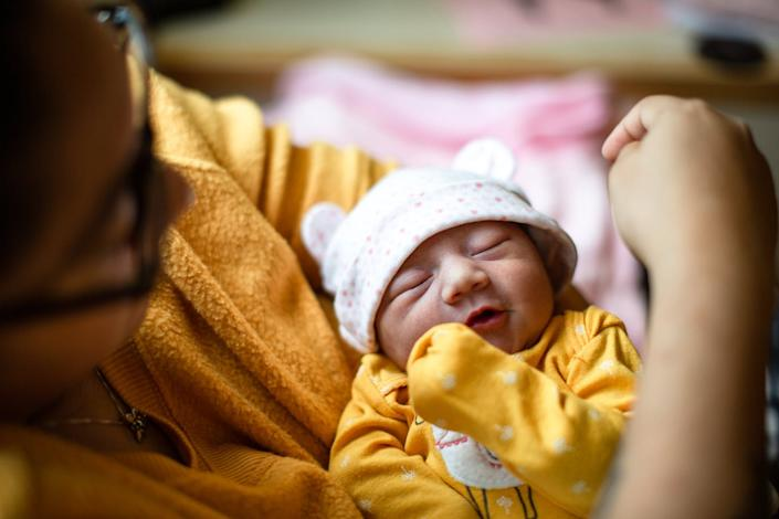 "<span class=""caption"">Studies show parental leave is linked to healthier babies.</span> <span class=""attribution""><a class=""link rapid-noclick-resp"" href=""https://www.gettyimages.com/detail/photo/day-old-newborn-hispanic-baby-royalty-free-image/1188784221?adppopup=true"" rel=""nofollow noopener"" target=""_blank"" data-ylk=""slk:Tim Newman via Getty Images"">Tim Newman via Getty Images</a></span>"