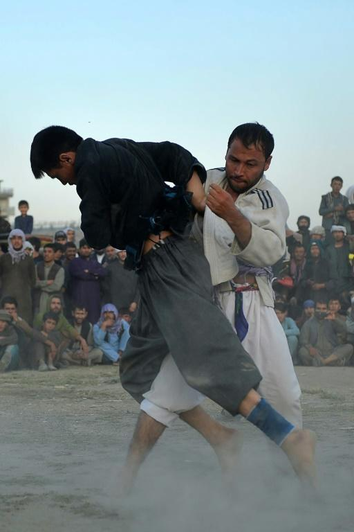 Judo and wresting are particularly popular in northern Afghanistan, with villages and districts producing local champions they put forward for regional contests and even national glory (AFP/Hoshang Hashimi)