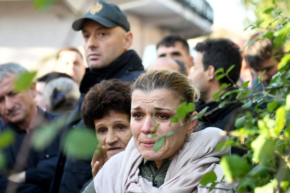 Relatives of people living at a collapsed building cry in Thumane, 34 kilometres (about 20 miles) northwest of capital Tirana, after an earthquake hit Albania, on November 26, 2019. (Photo: Gent Shkullaku/AFP via Getty Images)