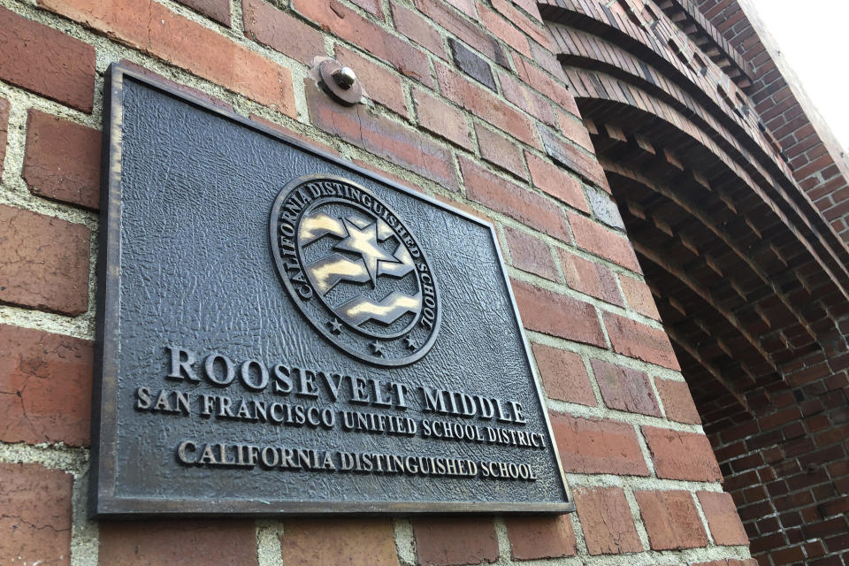 A plaque for Roosevelt Middle School is seen outside the school in San Francisco, on Wednesday, Jan. 27, 2021. The San Francisco school board voted Tuesday, Jan. 26, to remove the names of George Washington and Abraham Lincoln from public schools after officials deemed them and other prominent figures, including Sen. Dianne Feinstein, unworthy of the honor. Critics called the process slapdash, with little to no input from historians and a lack of information on the basis for each recommendation. In one instance, the committee didn't know whether Roosevelt Middle School was named after Theodore or Franklin Delano. (AP Photo/Haven Daley)
