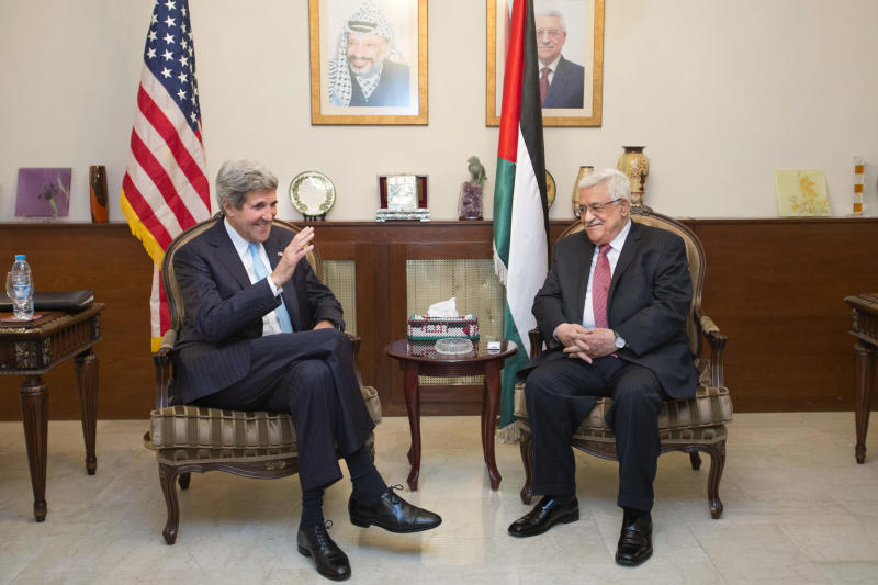 U.S. Secretary of State John Kerry, left, meets with Palestinian President Mahmoud Abbas in Amman, Jordan, on Friday, June 28, 2013. It is Kerry's fifth visit to the region since becoming secretary of state in February to try to restart peace talks between the Israelis and Palestinians, which broke down in 2008. (AP Photo/Jacquelyn Martin, Pool)