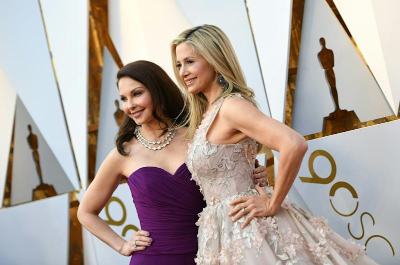 Ashley Judd and Mira Sorvino arrive for the 90th Annual Academy Awards. (VALERIE MACON via Getty Images)